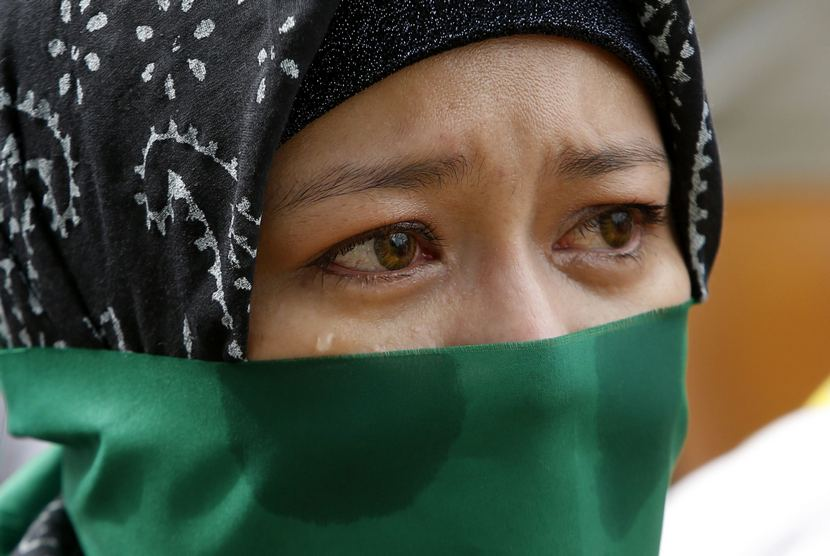 A Filipino Muslim Woman Sheds A Tear During A Rally Held By The Anak Mindanao Party List Group In Taguig